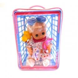 Muñeca en canasto con cepillo y patito